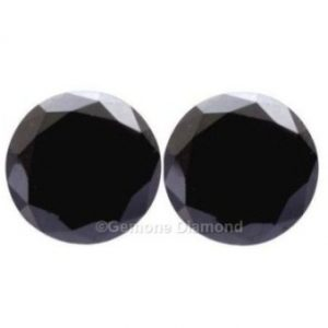pair of round cut black diamonds