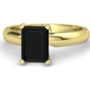solitaire emerald cut rings