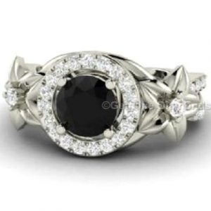round shaped natural black diamond engagement ring