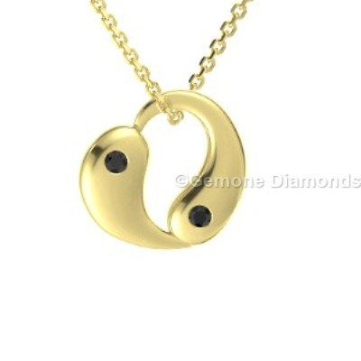 eye catching 14k yellow gold yin yang heart pendant with black diamonds
