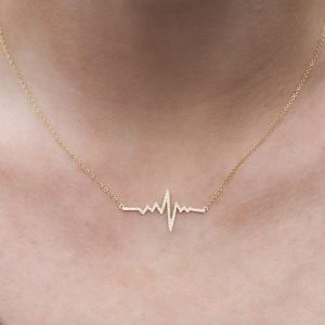 small heartbeat diamond pendant