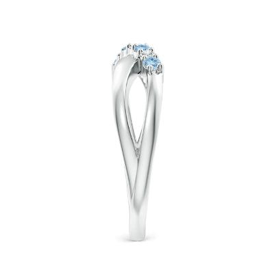 round aquamarine crossover ring