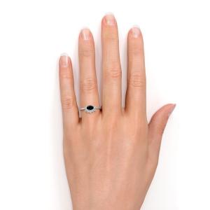 oval cut black diamond engagement ring