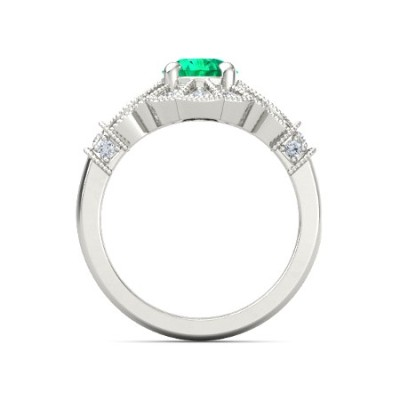 round cut emerald ring