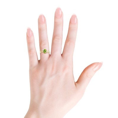 Oval shape peridot diamond ring