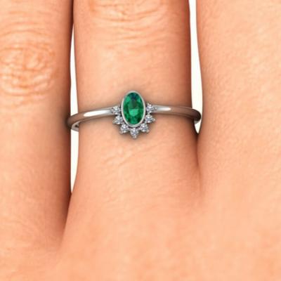 oval emerald diamond ring