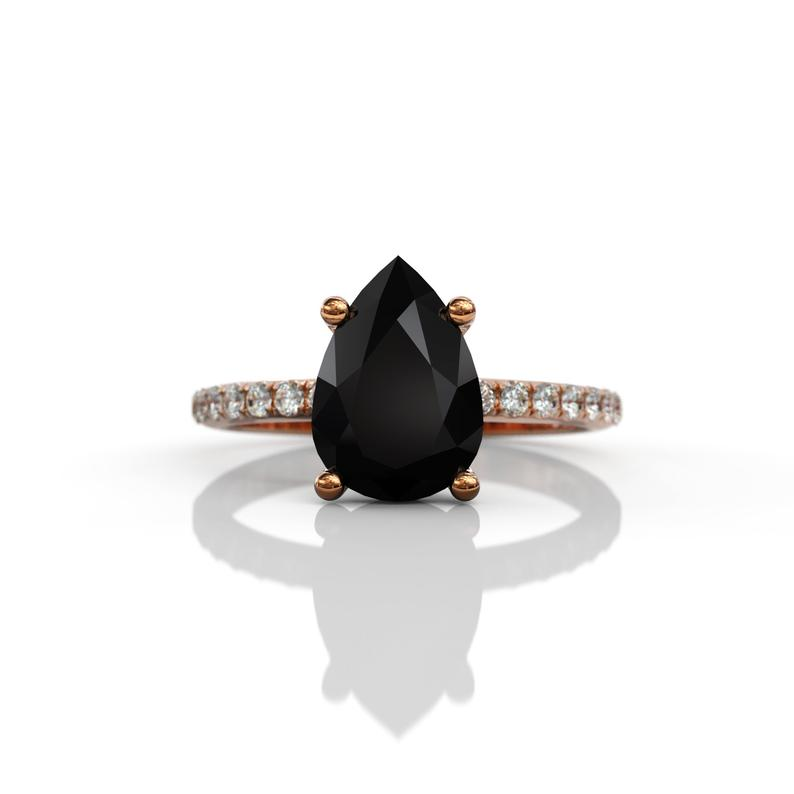 pear cut black diamond engagement ring