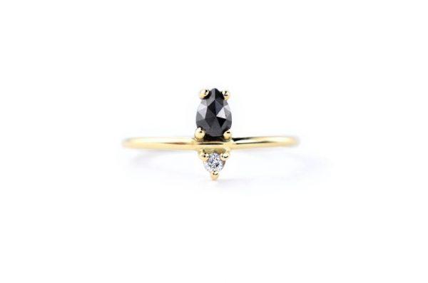 pear cut black diamond ring
